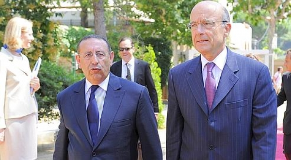 French Minister of Foreing Affairs Alain Juppe  walks with the new Secretary General of The Union for the Mediterranean (UfM) Moroccan Youssef Amrani , during Amrani\'s official take office ceremony.